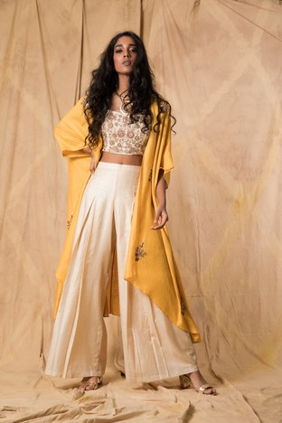 Anjali Jani, Ivory crop top and palazzo pants with a mustard cape